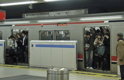 This is a late night train carrying revellers home from Shibuya – but even it's packed